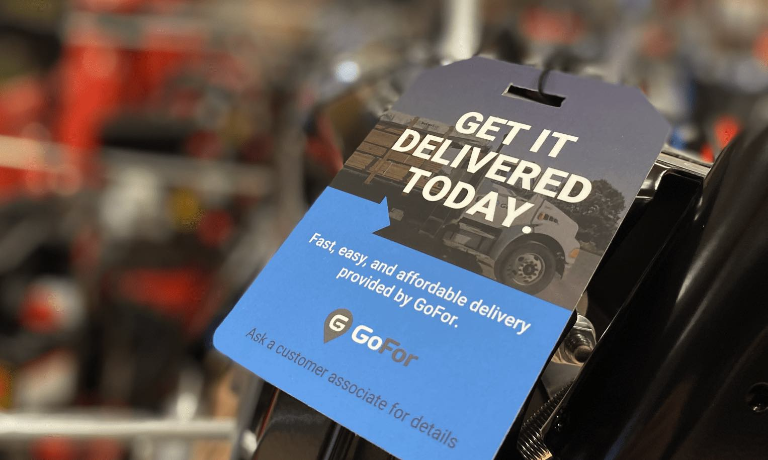 GoFor tag on a snowblower advertising on-demand delivery service for customers